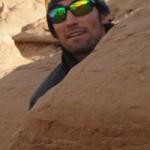 37-Adam-behind-rock