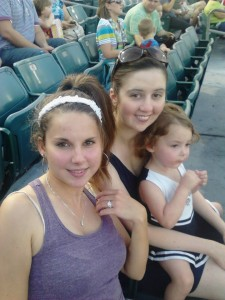 at a ball game with sister and niece